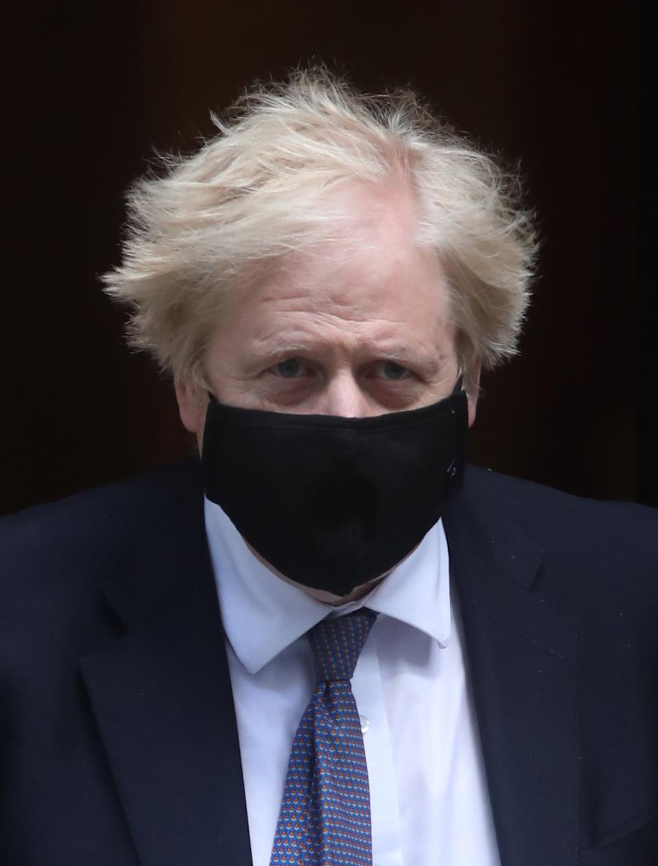 Prime Minister Boris Johnson leaves 10 Downing Street to attend Prime Minister's Questions at the Houses of Parliament, London. Picture date: Wednesday May 19, 2021. (Photo by Luciana Guerra/PA Images via Getty Images)