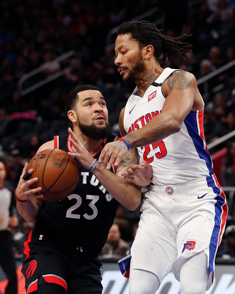 Toronto Raptors guard Fred VanVleet is defended by Detroit Pistons guard Derrick Rose during the first half Friday, Jan. 31, 2020, in Detroit.
