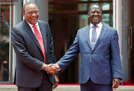 Kenya's President Uhuru Kenyatta greets opposition leader Raila Odinga of the National Super Alliance coalition after addressing a news conference at the Harambee house office in Nairobi