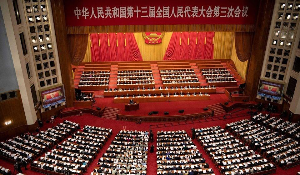 The PLA and its paramilitary arm, the People's Armed Police, together send about 400 delegates to the National People's Congress session at the Great Hall of the People in Beijing. Photo: AFP