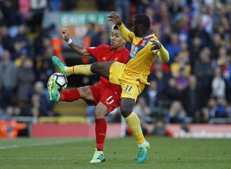 Britain Football Soccer - Liverpool v Crystal Palace - Premier League - Anfield - 23/4/17 Crystal Palace's Jeffrey Schlupp in action with Liverpool's Roberto Firmino Reuters / Phil Noble Livepic