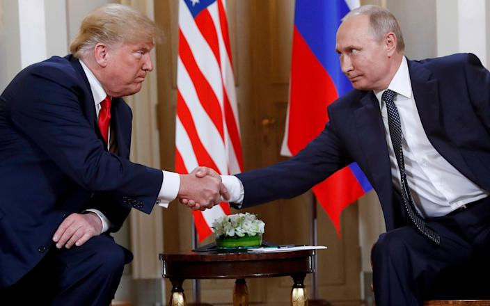 US President Donald Trump and Russian President Vladimir Putin at a meeting at the Presidential Palace in Helsinki, Finland, in 2018 - Pablo Martinez Monsivais/AP
