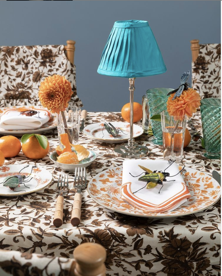 """<p>It's all about a pop of color in <a href=""""https://housesandparties.com/"""" rel=""""nofollow noopener"""" target=""""_blank"""" data-ylk=""""slk:Rebecca Gardener's"""" class=""""link rapid-noclick-resp"""">Rebecca Gardener's</a> world of entertaining. Keeping the table in fall hues of brown and orange makes the bold aqua of the tea light shade pop for a show-stopping statement.</p>"""