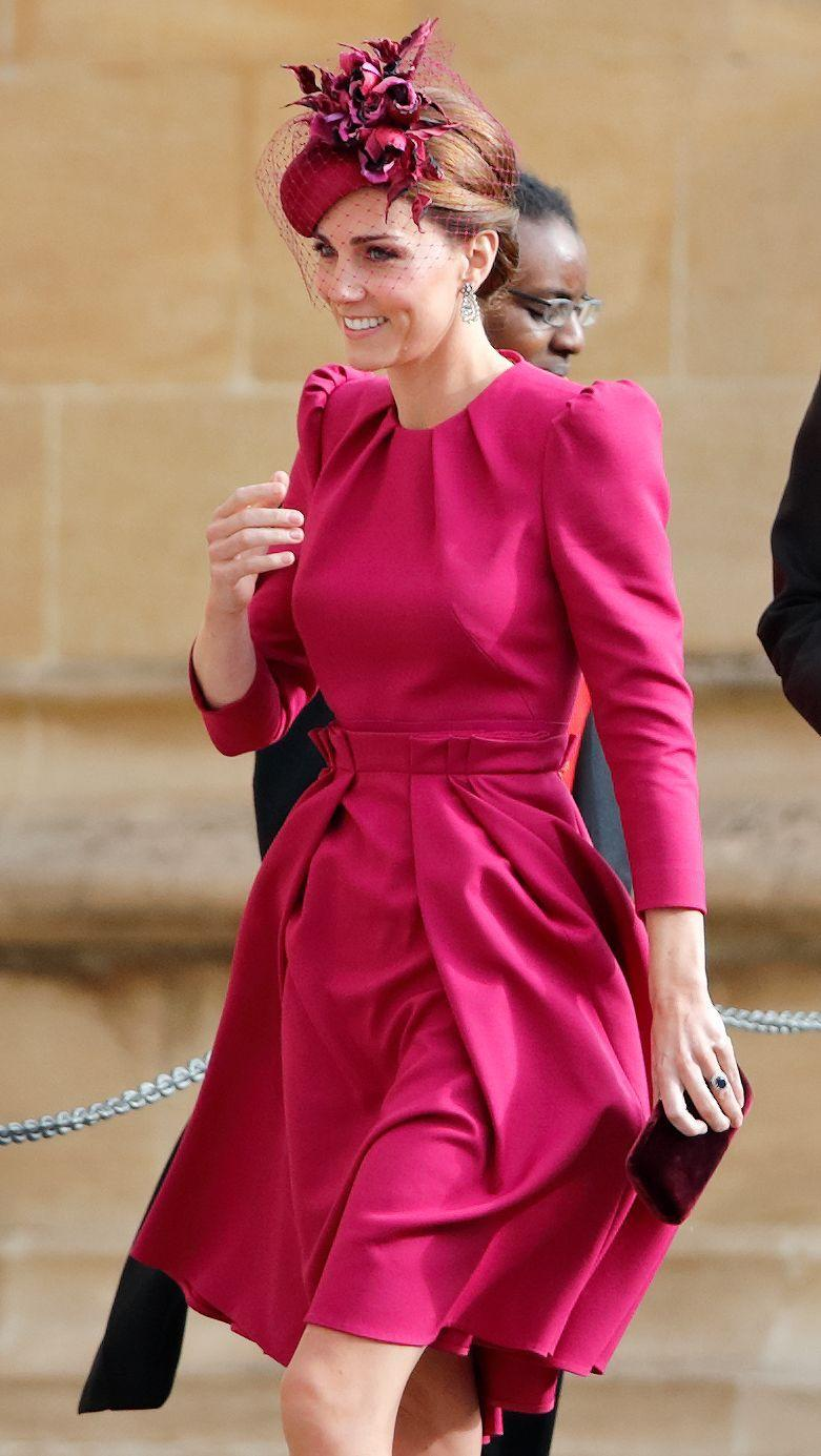 """<p>Kate looked luxe in this magenta dress and hat combo at Princess Eugenie's wedding to <a href=""""https://www.townandcountrymag.com/society/tradition/a15839639/jack-brooksbank-facts/"""" rel=""""nofollow noopener"""" target=""""_blank"""" data-ylk=""""slk:Jack Brooksbank"""" class=""""link rapid-noclick-resp"""">Jack Brooksbank</a>.</p>"""