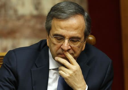 Greek Prime Minister Antonis Samaras reacts in parliament during the last round of a presidential vote in Athens December 29, 2014. REUTERS/Yannis Behrakis