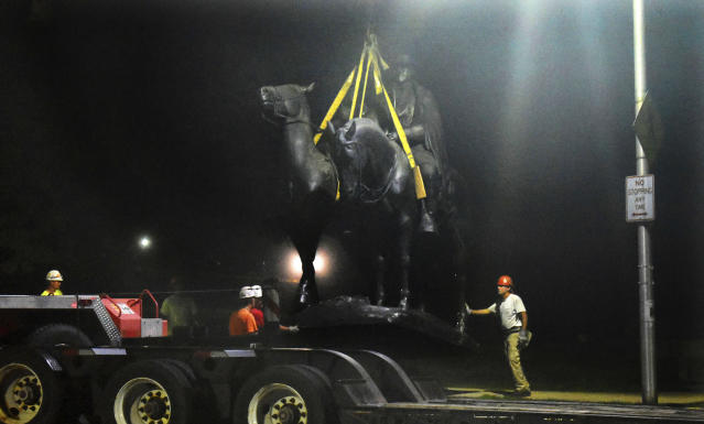 "<p>Workers remove the Robert E. Lee and Thomas J. ""Stonewall"" Jackson monument in Wyman Park early Wednesday, Aug. 16, 2017, in Baltimore. Local news outlets reported that workers hauled several monuments away, days after a white nationalist rally in Virginia turned deadly. (Photo: Denise Sanders/The Baltimore Sun via AP) </p>"