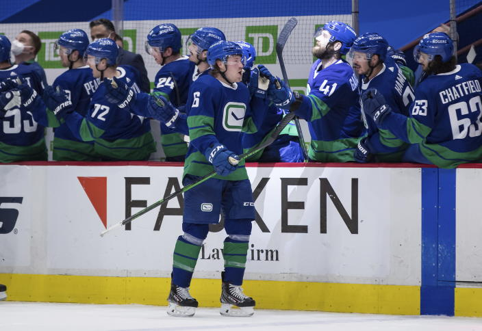 Vancouver Canucks' Brock Boeser (6) celebrates after scoring a goal against the Calgary Flames during the third period of an NHL hockey game, Sunday, May 16, 2021, in Vancouver, British Columbia. (Darryl Dyck/The Canadian Press via AP)