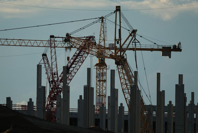 GRUENHEIDE, GERMANY - AUGUST 31: Cranes stand at the construction site of the new Tesla Gigafactory near Berlin on August 31, 2020 near Gruenheide, Germany. The factory is scheduled to begin producing Tesla electric cars in the summer of 2021. (Photo by Sean Gallup/Getty Images)