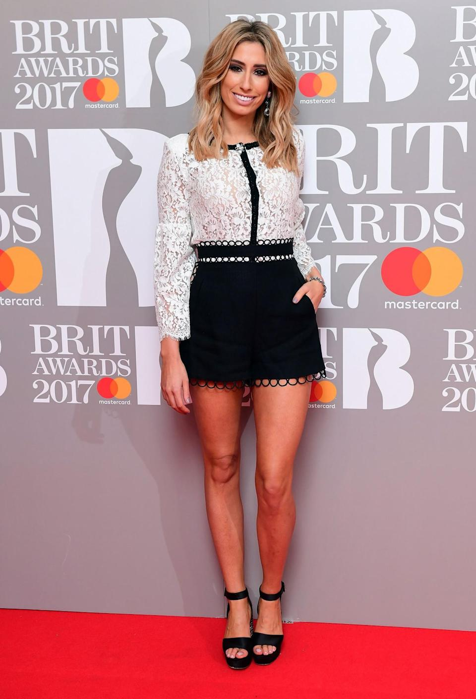 <p>Everyone's favourite Essex girl donned a short monochrome outfit. <i>[Photo: PA]</i> </p>
