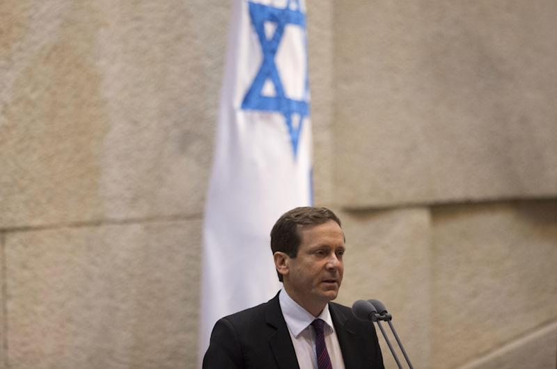 "In this photo taken on Monday, Jan. 20, 2014, Israel's opposition leader and Labor Party leader Isaac Herzog speaks at the Knesset, Israel's Parliament, in Jerusalem. Israel's opposition leader said Tuesday that Prime Minister Benjamin Netanyahu fully appreciates the wisdom of making peace with the Palestinians. He's just not sure he has the ""guts."" Herzog, who was elected head of the Labor Party in November, said that his ultimate goal is to replace Netanyahu. But he said he would back the prime minister if he genuinely pursues peace with the Palestinians and offered a political ""safety net"" should Netanyahu's right-leaning coalition rebel in case of substantial progress in recently restarted peace talks.(AP Photo/Ariel Schalit)"