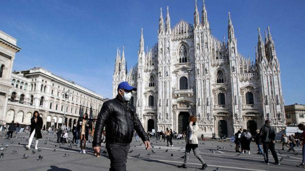 PHOTO: a man walks past the Duomo gothic cathedral in Milan, Italy. (Luca Bruno/AP)