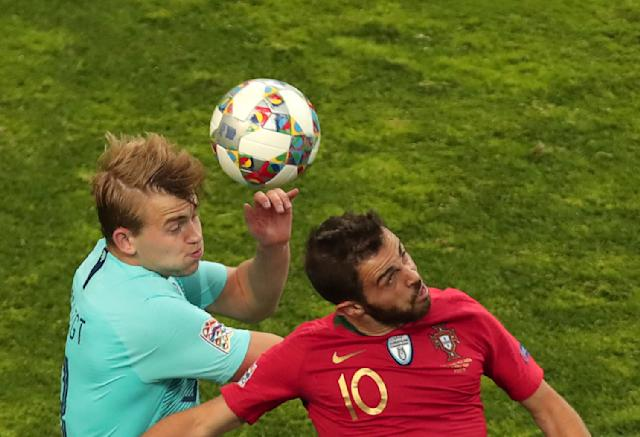 Portugal's Bernardo Silva, right, jumps for the ball with Netherlands' Matthijs de Ligt during the UEFA Nations League final soccer match between Portugal and Netherlands at the Dragao stadium in Porto, Portugal, Sunday, June 9, 2019. (AP Photo/Luis Vieira)