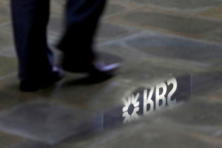 FILE PHOTO: A man walks past a Royal Bank of Scotland branch logo reflected in a puddle in London, Britain, January 14, 2010.   REUTERS/Stefan Wermuth/File Photo