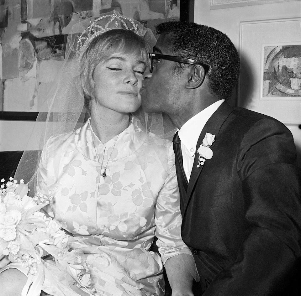 """<p>Sammy Davis Jr. met Swedish actress May Britt on the lot of 20th Century Fox. The couple married on June 6, 1960, which <a href=""""https://www.smithsonianmag.com/arts-culture/hollywood-loved-sammy-davis-jr-until-he-dated-white-movie-star-180964395/"""" rel=""""nofollow noopener"""" target=""""_blank"""" data-ylk=""""slk:garnered a lot of attention"""" class=""""link rapid-noclick-resp"""">garnered a lot of attention</a>, as interracial marriages were not common at the time. Despite the public discourse surrounding their union, the couple was married for eight years before divorcing in 1968.</p>"""