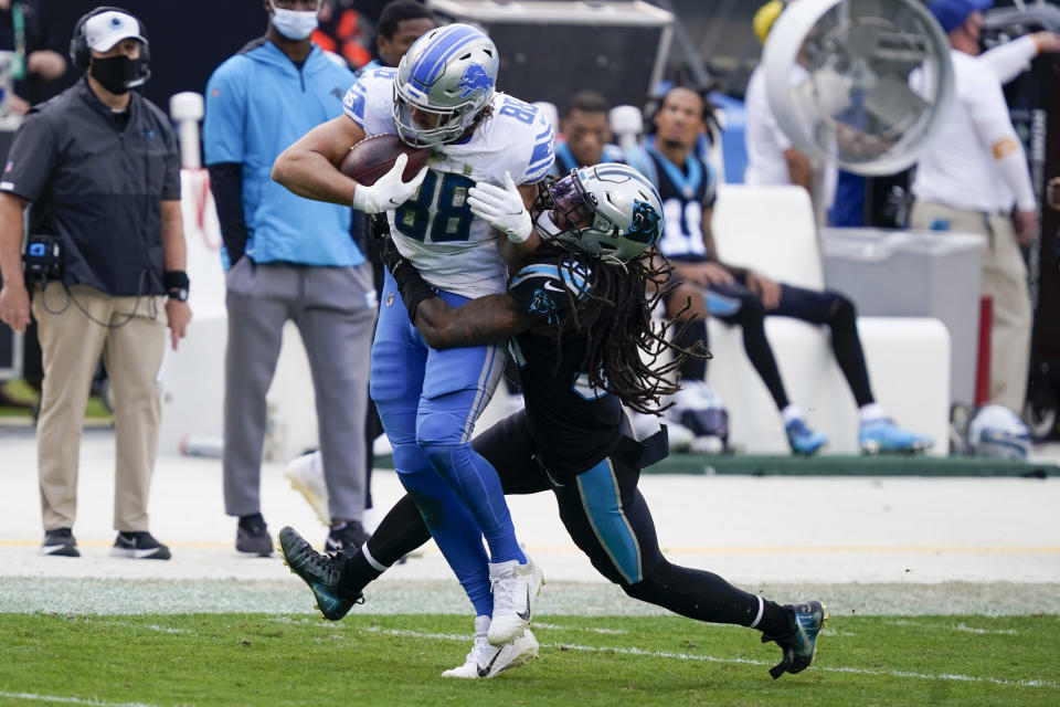 Detroit Lions tight end T.J. Hockenson is tackled by Carolina Panthers free safety Tre Boston during the second half of an NFL football game Sunday, Nov. 22, 2020, in Charlotte, N.C. (AP Photo/Gerry Broome)