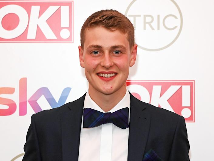 """Peter Sawkins, winner of """"Bake Off"""" in 2020, is pictured at a red carpet event in 2021."""