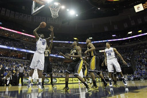 Memphis' Tarik Black (10) goes to the basket over Southern Miss' Rashard McGill (12), Deon Edwin (15) and Daveon Boardingham, center, as Memphis' Geron Johnson (55) watches the play during the first half of an NCAA college basketball game in Memphis, Tenn., Saturday, Feb. 23, 2013. (AP Photo/Danny Johnston)