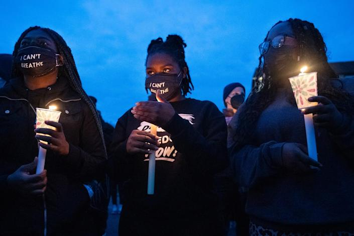 Protesters hold candles