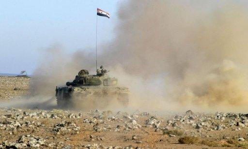 The Syrian military performs live ammunition exercises at an undisclosed location on December 4. Syria said on Monday it conditionally accepts observers as part of an Arab plan, as a rights group reported militiamen loyal to the regime killed 34 civilians and dumped their bodies in a city square