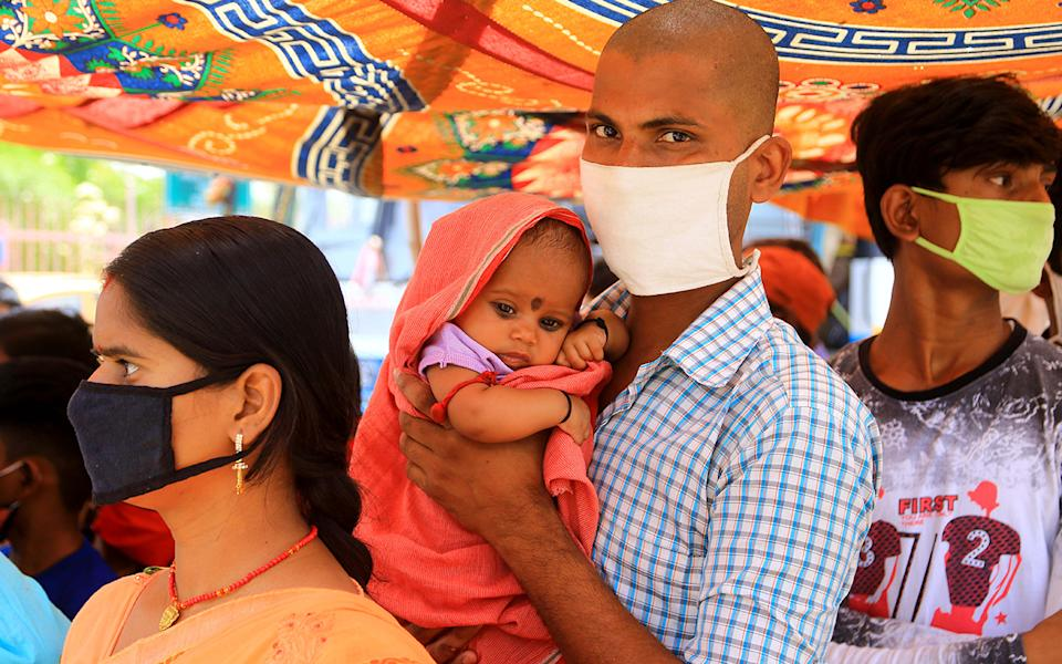 Migrants stand in a queue as they wait for transport out of Jaipur, India amid the coronavirus lockdown. Source: Getty