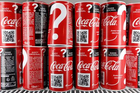 Cans of Coca-Cola are pictured in the refrigerator during an event in Paris