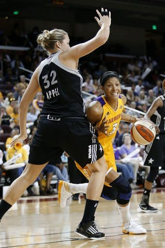 Los Angeles Sparks' Candace Parker, right, is defended by San Antonio Silver Stars' Jayne Appel during Game 1 of a WNBA basketball first-round playoff series, in Los Angeles on Thursday, Sept. 27, 2012. (AP Photo/Jae C. Hong)