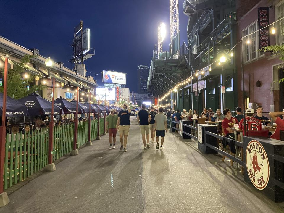 Fans stroll down a not-that-packed street outside Fenway Park. (Yahoo Sports)