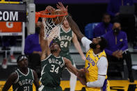Milwaukee Bucks forward Giannis Antetokounmpo (34) dunks against Los Angeles Lakers center Andre Drummond (2) during the second quarter of an NBA basketball game Wednesday, March 31, 2021, in Los Angeles. (AP Photo/Ashley Landis)
