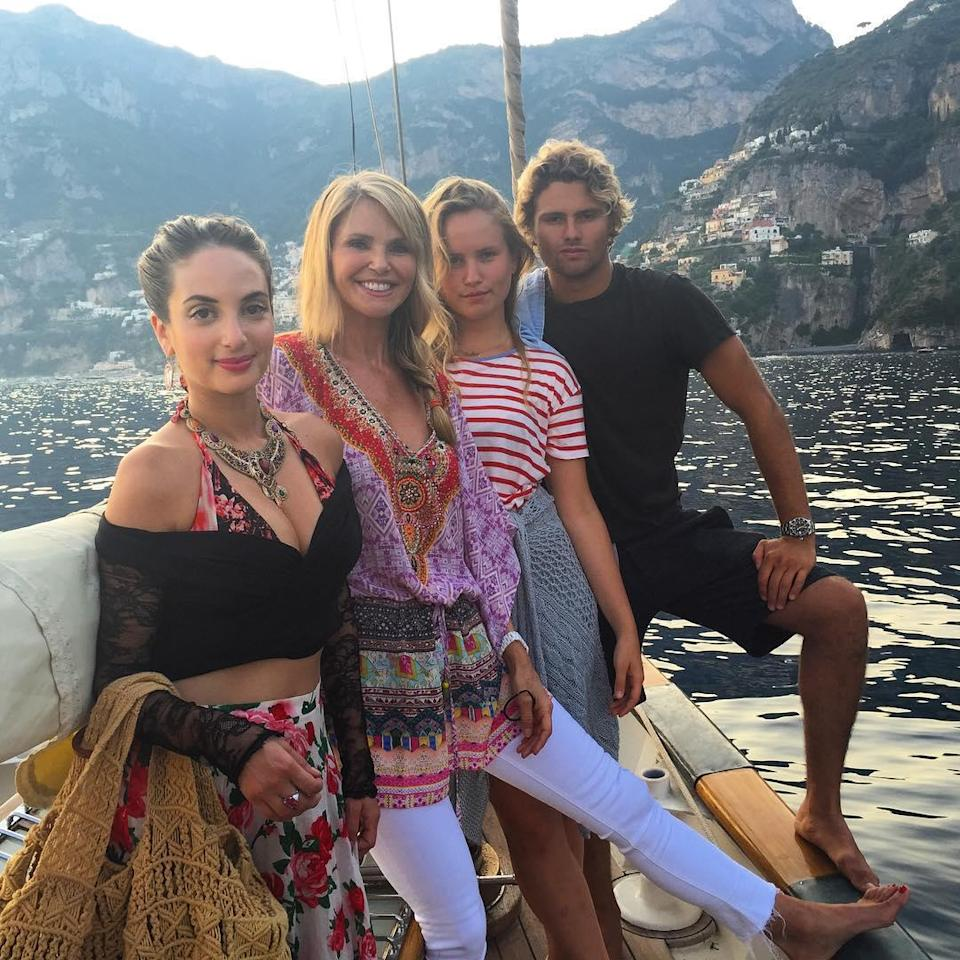 """Looking <em>good</em>, Christie Brinkley! The legendary supermodel looked incredible during her recent family trip to Italy, pretty much ageless in a white bikini showing off her flawless bod. ... She's 61?! <strong>WATCH: Christie Brinkley Strips for Safety</strong> """"We are approaching Stromboli, a volcano that is a sight to behold at night!"""" she explained about the gorgeous shot. """"We have been in the most gorgeous and remote areas of Italy the past couple days. ... These natural wonders will make you want to protect our ocean waters all over this magnificent planet, and inspire dreamers!"""" It's safe to say Christie is as beautiful as ever these days. Christie has been documenting her enviable Italian vacay with her three children -- Alexa Ray, Jack, and Sailor -- on Instagram. Check out her handsome 20-year-old son Jack modeling shirtless in the picturesque setting. Of course, Christie also proudly shared pics of her girls, Alexa, 29, and Sailor, 16. The Brinkley family vacation definitely looks like the trip of all our dreams. Activities included cliff-diving and lots of amazing sight-seeing. Is this not one of the most gorgeous families you've ever seen?! <strong>NEWS: Christie Brinkley and Her Ex-Husband's Other Ex-Wife Kiss And Make Up</strong> Hopefully though, this vacation was accident-free -- In April, Christie suffered a black eye trying to save a bird during her vacation to Parrot Cay in Turks and Caicos. Watch below:"""