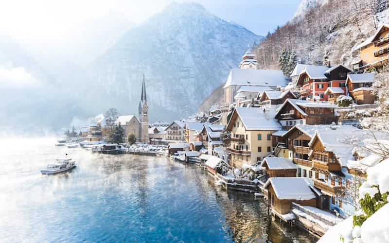 Postcard depicting the famous Hallstatt lakeside town in the Alps - iStockphoto