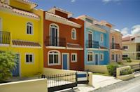 <p>Crisp and bright like the Punta Cana sun, these colorful stucco buildings will make you smile.</p>