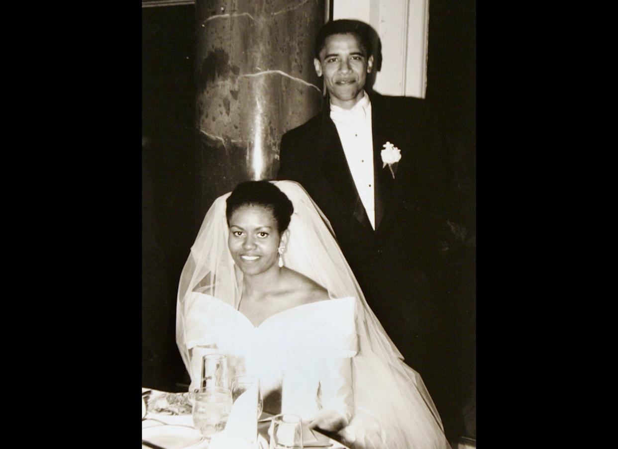 This black-and-white photo released by Obama for America shows President Barack Obama and his bride Michelle Robinson on their wedding day Oct. 18, 1992, in Chicago. After his first year at Harvard, Obama was a summer associate at a corporate law firm in Chicago where his adviser was Robinson, another Harvard law graduate. They later married, and had two daughters, Malia and Sasha.