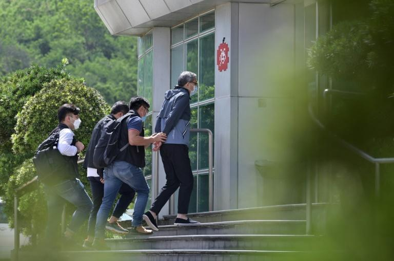 CEO Cheung Kim-hung was led by officers into Apple Daily's building with his hands fastened behind him