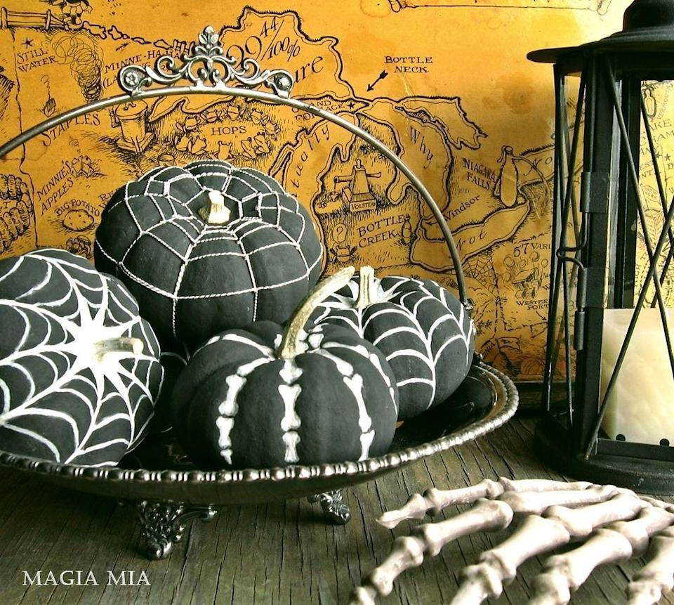 """<p>The season just wouldn't be complete without skeleton bones and fake spiderwebs (emphasis on the <em>fake</em>).</p><p><em><a href=""""http://magiamia.blogspot.com/2012/10/playing-with-petite-pumpkins.html"""" rel=""""nofollow noopener"""" target=""""_blank"""" data-ylk=""""slk:Get the tutorial at Magia Mia »"""" class=""""link rapid-noclick-resp"""">Get the tutorial at Magia Mia »</a></em></p>"""