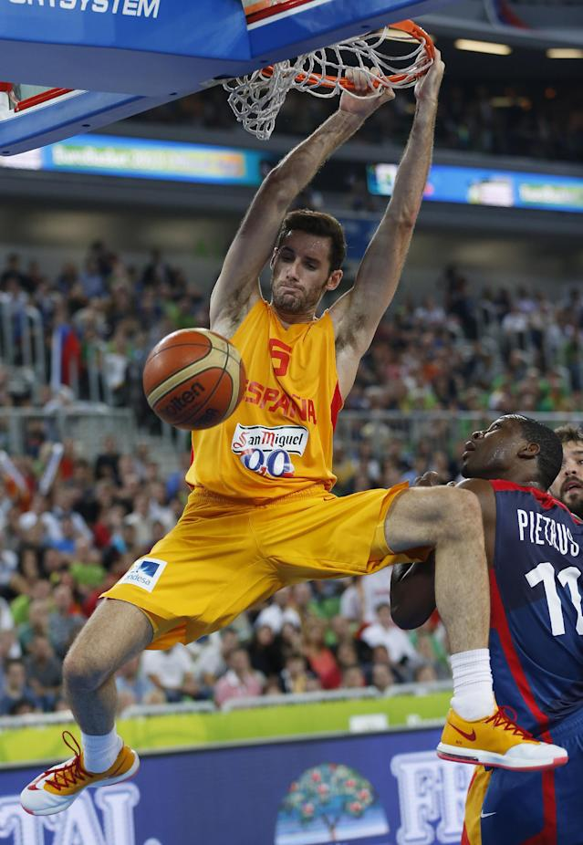 France's Florent Pietrus, right, looks on as Spain's Rudy Fernandez, left, dunks a ball during their EuroBasket European Basketball Championship semifinal match in Ljubljana, Slovenia, Friday, Sept. 20, 2013. (AP Photo/Petr David Josek)