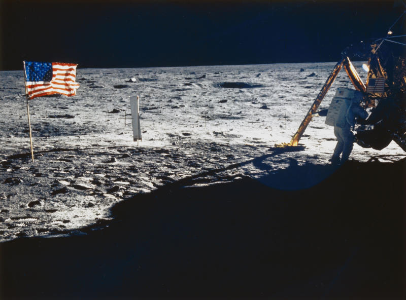 UNITED STATES - MAY 08: Armstrong is shown beside the Lunar Module. Also visible are the US flag and the solar wind experiment which was flown on all the Apollo missions. Apollo 11, the first manned lunar landing mission, was launched on 16th July 1969 and Armstrong and Edwin �Buzz� Aldrin became the first and second men to walk on the Moon on 20th July 1969. The third member of the crew, Command Module pilot Michael Collins remained in lunar orbit while Armstrong and Aldrin were on the surface. (Photo by SSPL/Getty Images)