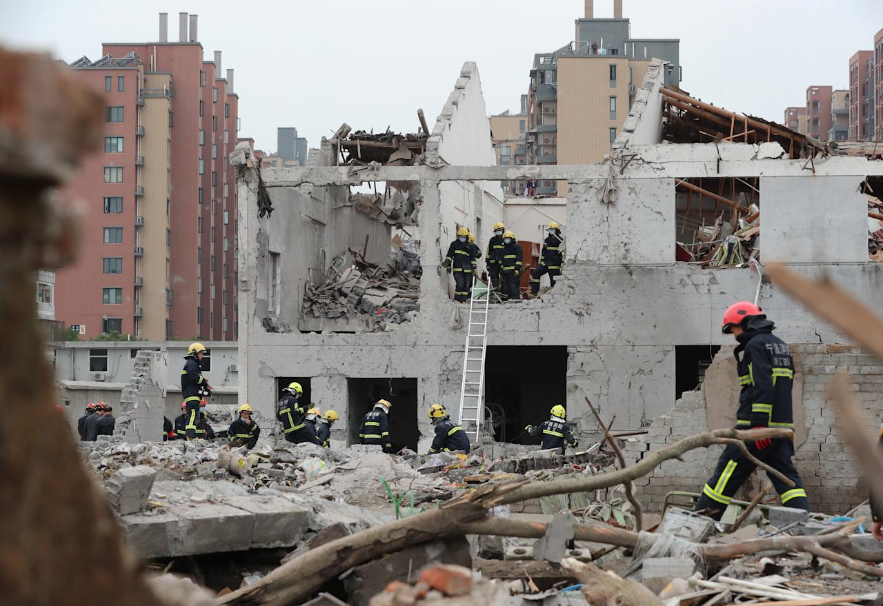 <p>Rescue workers are seen at the site of an explosion in Ningbo, China's eastern Zhejiang province on Nov. 26, 2017. (Photo: STR/AFP/Getty Images) </p>