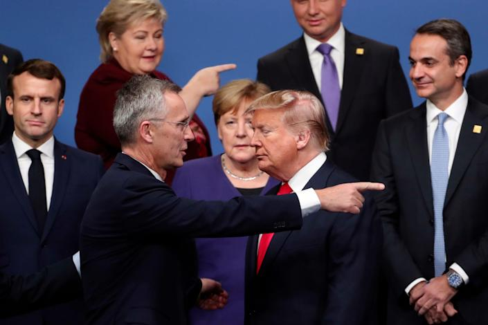 In this Dec. 4, 2019, file photo, NATO Secretary-General Jens Stoltenberg, front left, speaks with U.S. President Donald Trump, front right, after a group photo at a NATO leaders meeting at The Grove hotel and resort in Watford, Hertfordshire, England.
