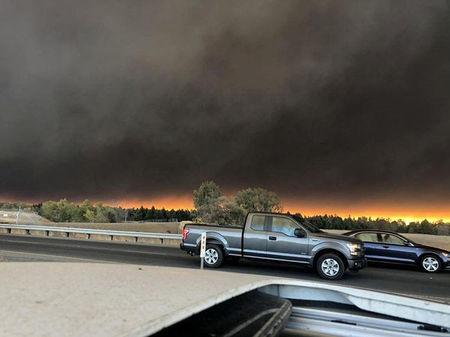 Vehicles are seen during evacuation from Paradise to Chico in Butte County California U.S in this