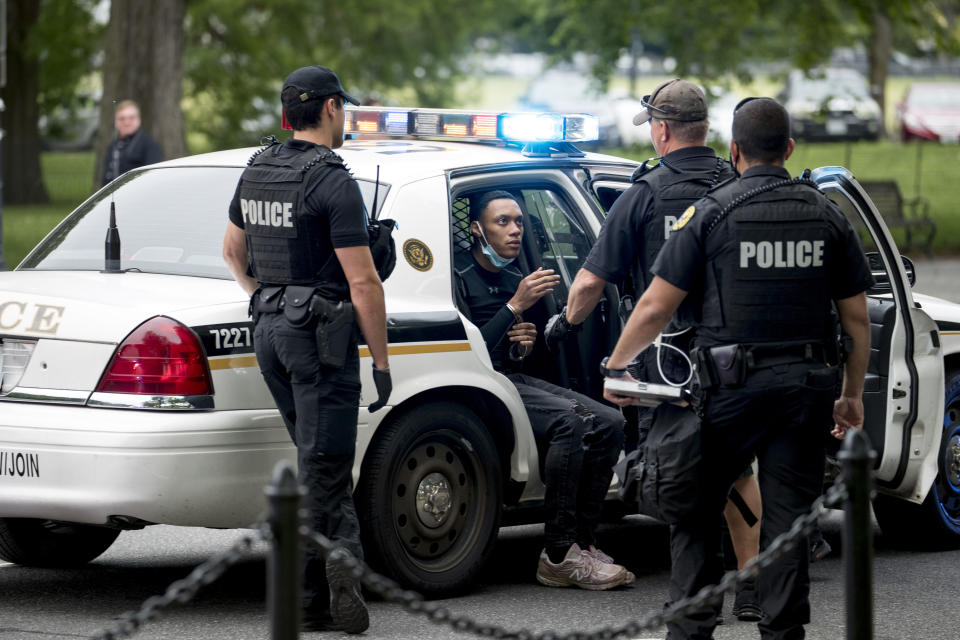 U.S. Secret Service police arrest a man for what one eye witness said an officer told him was for having an imitation gun along Constitution Avenue near the White House in the morning as protests continue over the death of George Floyd in Washington, Tuesday, June 2, 2020. Floyd died after being restrained by Minneapolis police officers. (AP Photo/Andrew Harnik)