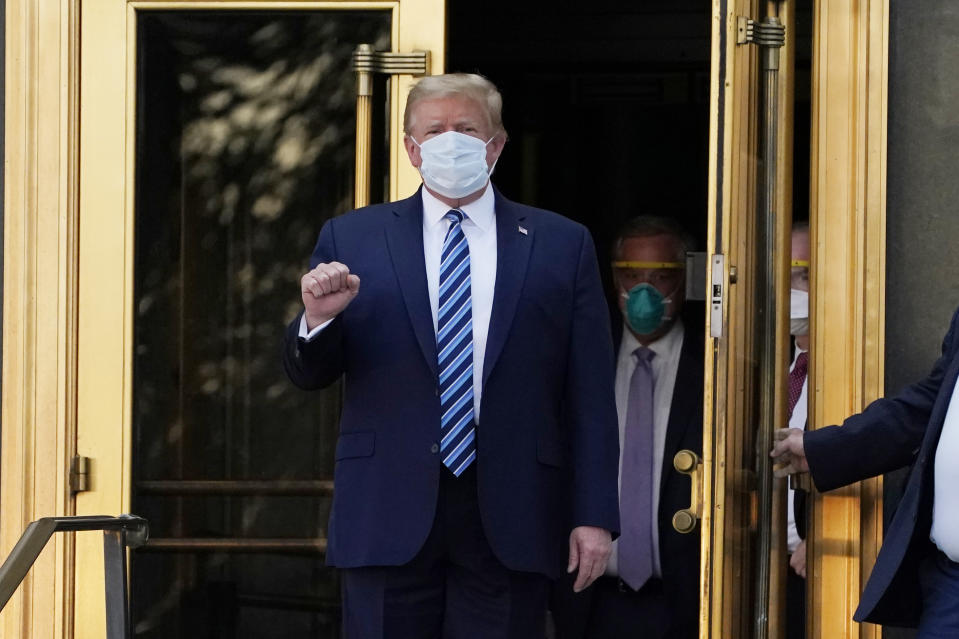 President Donald Trump walks out of Walter Reed National Military Medical Center after receiving treatments for Covid-19, Monday, Oct. 5, 2020, in Bethesda, Md.
