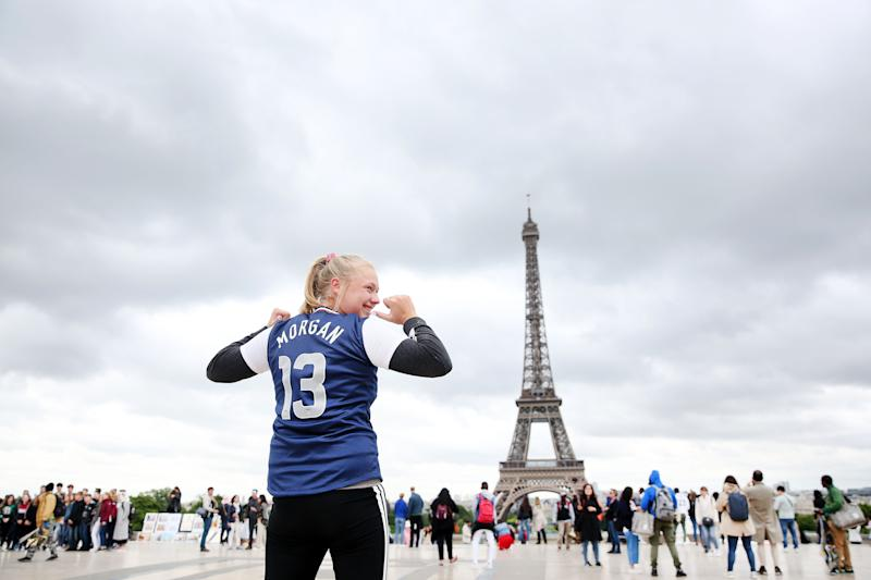 PARIS, FRANCE - JUNE 13: A fan poses in an Alex Morgan jersey in front of the Eiffel Tower during the FIFA Women's World Cup on June 13, 2019 in Paris, France. (Photo by Marianna Massey - FIFA/FIFA via Getty Images)