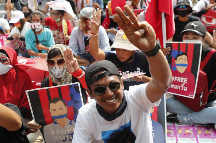 A pro-democracy activist, Jatupat Boonpattararaksa gestures with a three-fingers salute, a symbol of resistance as he arrived at the Attorney General office in Bangkok, Thailand, Monday, March 8, 2021. Prosecutors in Thailand charged 18 pro-democracy activists with sedition on Monday, while lodging additional charges of insulting the monarchy against three of them. (AP Phioto/Sakchai Lalit)