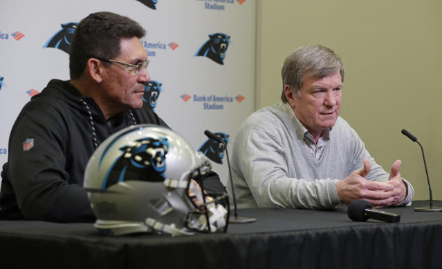Carolina Panthers general Manager Marty Hurney, right, answers a question as head coach Ron Rivera listens during a NFL football pre-draft news conference in Charlotte, N.C., Tuesday, April 24, 2018. (AP Photo/Chuck Burton)
