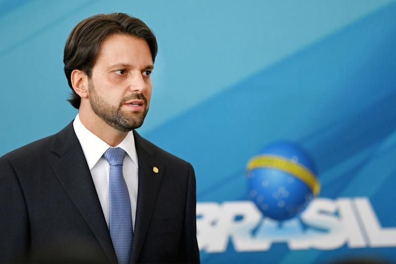 Brazilian new Minister of Cities Alexandre Baldy gestures during his inauguration ceremony at Planalto Palace in Brasilia, on November 22, 2017. Temer initiated a ministerial reform to increase support in the National Congress and to be able to approve economic reforms. / AFP PHOTO / EVARISTO SA (Photo credit should read EVARISTO SA/AFP via Getty Images)