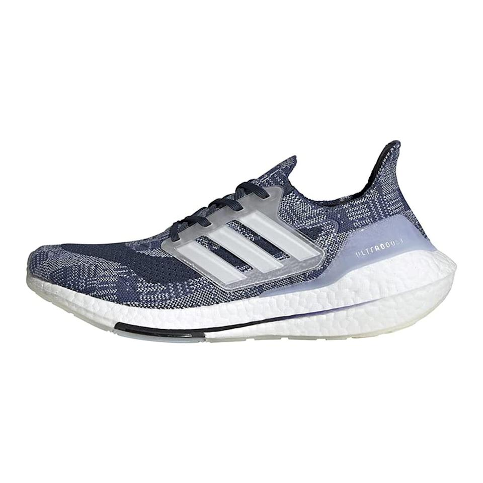 """<p><strong>adidas</strong></p><p>amazon.com</p><p><strong>$128.68</strong></p><p><a href=""""https://www.amazon.com/dp/B0894713D8?tag=syn-yahoo-20&ascsubtag=%5Bartid%7C2139.g.36687307%5Bsrc%7Cyahoo-us"""" rel=""""nofollow noopener"""" target=""""_blank"""" data-ylk=""""slk:BUY IT HERE"""" class=""""link rapid-noclick-resp"""">BUY IT HERE</a></p><p>Between the cushioned sole and the lightweight feel, your runs are sure to feel like a breeze in Adidas' Ultraboost 21 sneakers. And for a sustainable fun fact, the comfortable knit upper is made with recycled polyester.</p>"""
