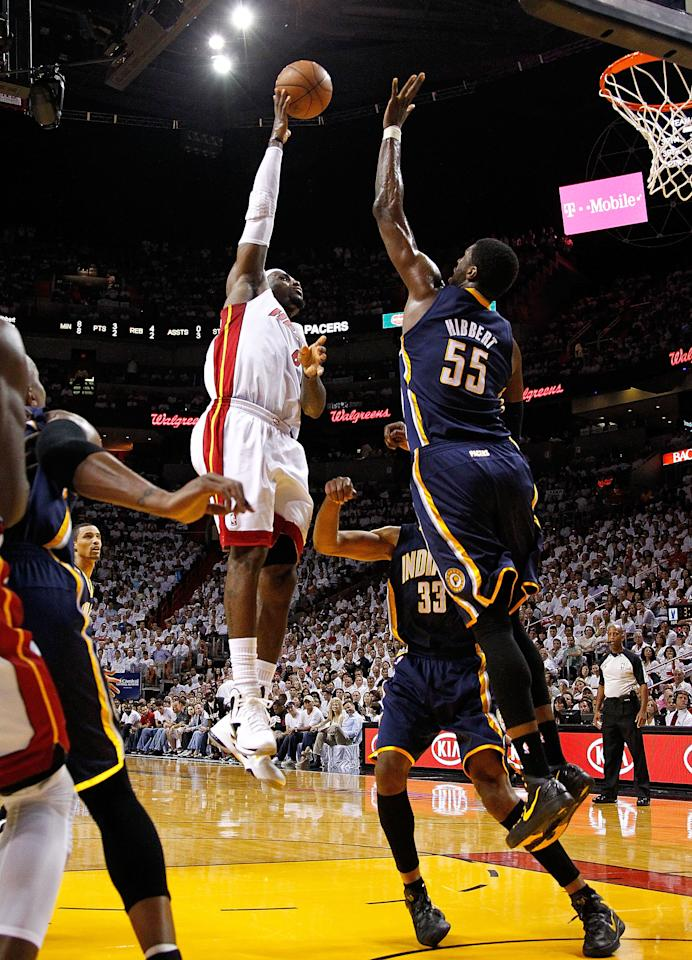 MIAMI, FL - MAY 22: LeBron James #6 of the Miami Heat shoots over Roy Hibbert #55 of the Indiana Pacers during Game Five of the Eastern Conference Semifinals in the 2012 NBA Playoffs  at AmericanAirlines Arena on May 22, 2012 in Miami, Florida. NOTE TO USER: User expressly acknowledges and agrees that, by downloading and/or using this Photograph, User is consenting to the terms and conditions of the Getty Images License Agreement.  (Photo by Mike Ehrmann/Getty Images)