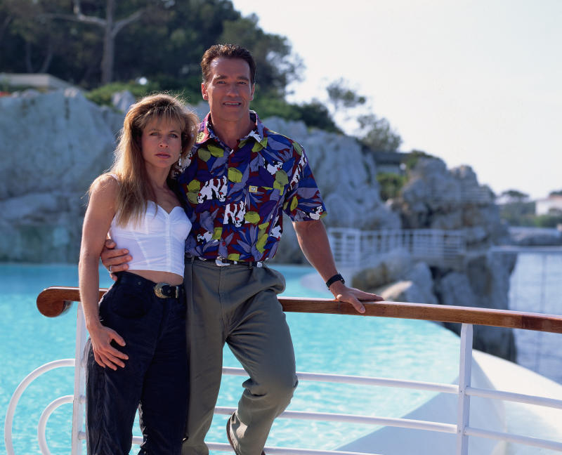 The American actress Linda Hamilton and the Austrian-born actor Arnold Schwarzenegger stand by a pool in Cannes, France. They have worked together on the films The Terminator and Terminator 2: Judgment Day. (Photo by Kurt Krieger/Corbis via Getty Images)