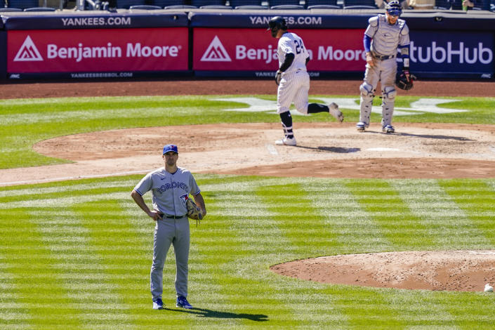 Toronto Blue Jays starting pitcher Ross Stripling, left, reacts after giving up a home run to New York Yankees' Gary Sanchez during the fourth inning of a baseball game, Saturday, April 3, 2021, in New York. (AP Photo/John Minchillo)