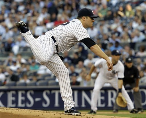 New York Yankees starting pitcher Phil Hughes delivers against the Cleveland Indians in the first inning of a baseball game at Yankee Stadium in New York, Tuesday, June 26, 2012. (AP Photo/Kathy Willens)